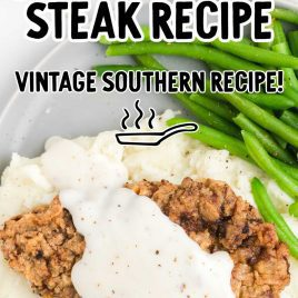 overhead shot of Chicken Fried Steak topped with homemade gravy and served with mashed potatoes and green beans on a plate