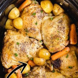 close up overhead shot of a crockpot of Crockpot Chicken Recipe with potatoes and carrots