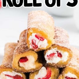 close up shot of French Toast Roll-Ups rolled in cinnamon sugar piled on a plate