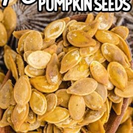 close up shot of a bunch of Roasted Pumpkin Seeds on a wooden spoon