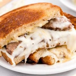 close up shot of a Steak Grilled Cheese sandwich on a plate