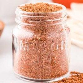 close up shot of a mason jar filled with Taco Seasoning