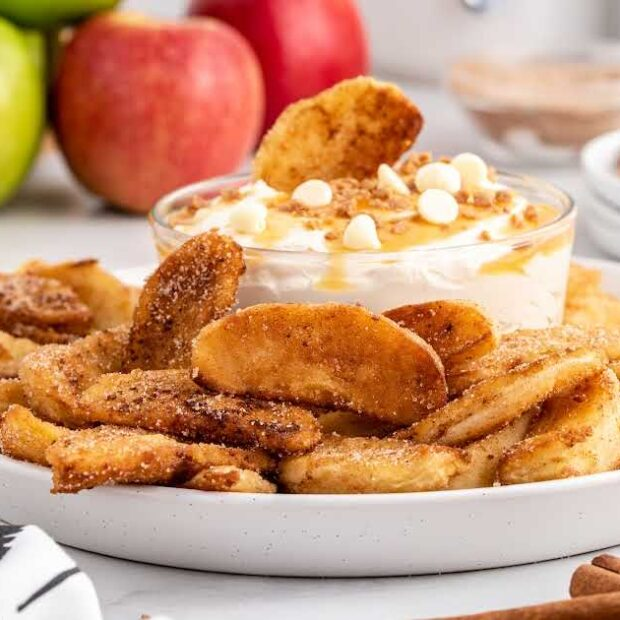close up shot of a plate of Apple Fries with a bowl of dipping sauce