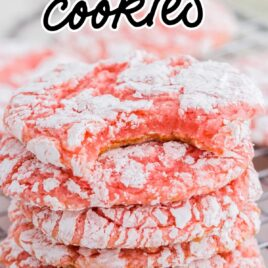 close up shot of Cool Whip Cookies stacked on top of each other on a cooling rack