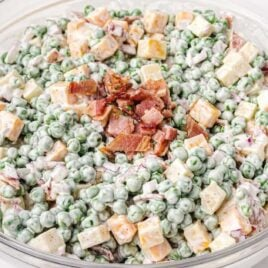 close up shot of a bowl of Pea Salad topped with bacon bits