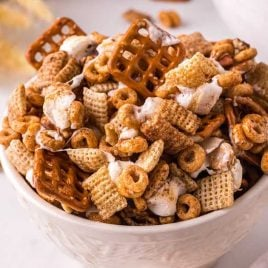 close up shot of a bowl of Pumpkin Spice Chex Mix