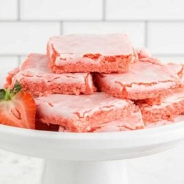 close up shot of Strawberry Brownies stacked on top each other on a serving plate