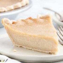 close up shot of a slice of Sugar Pie on a plate with a fork