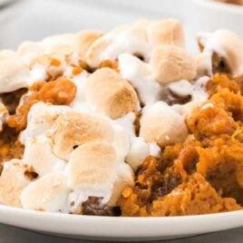 close up shot of a serving of Sweet Potato Casserole on a plate