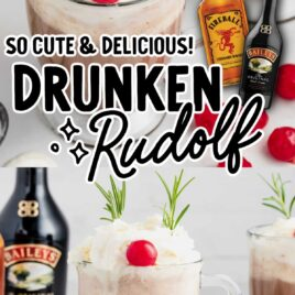 close up shot of a glass of drunken Rudolf topped with whipped cream and garnished with a maraschino cherry and rosemary