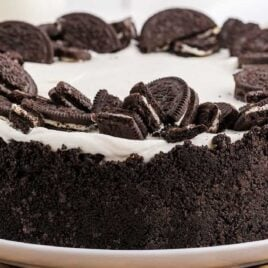 close up shot of a no bake oreo cheesecake topped with crushed Oreos on a plate