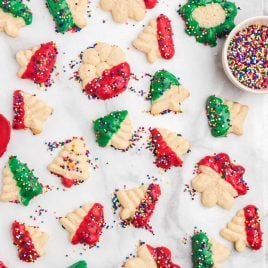 close up overhead shot of spritz cookies on parchment paper